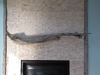 Driftwood mantle inspiration - nice idea framing out the tile with complimentary wood pieces.
