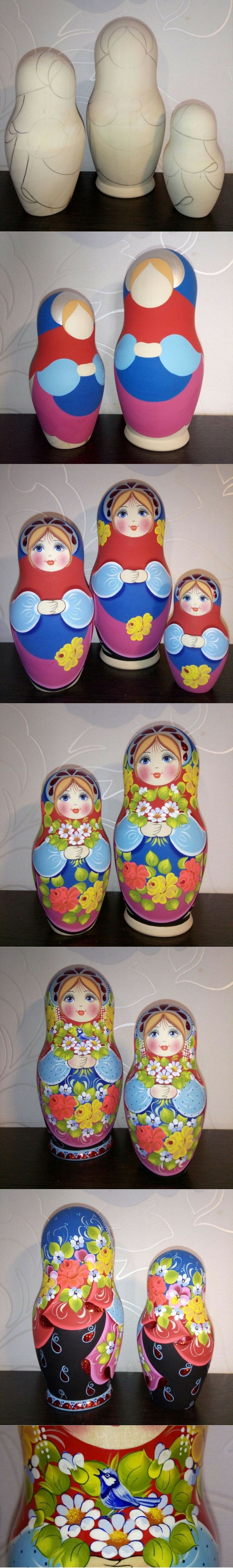 Matryoshka doll with blue wren in her hands, created by artist Nadezhda Tihonovich