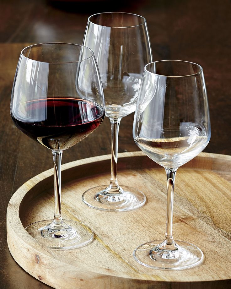 Nattie's tulip-shaped bowls square up just a bit to put a modern angle on classic glassware. Machine-made to look handcrafted, these glasses are a great value and available in a range of shapes to bring out the best of red, whites and sparkling wines.