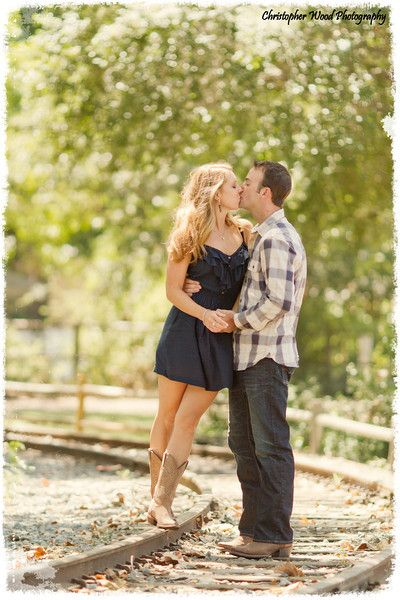 Train Track Couple Kiss (Christopher Wood Photography) i have a white dress like this with cowboy boots that would look PERFECT!