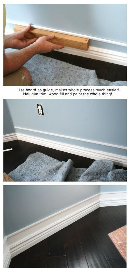 Add a strip of trim a bit above already existing baseboards, paint between, and you get faux thick baseboards!  LOVE THE DARK FLOOR AS WELL