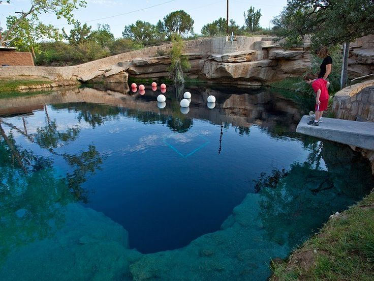 """THE BLUE HOLE  Santa Rosa, New Mexico    Santa Rosa, New Mexico owes a large part of its designation as """"The Scuba Diving Capital of the Southwest"""" to The Blue Hole, an 80-foot-deep natural artesian spring that—at 64 degrees—allows for year-round diving. Witness the wonder of this bell-shaped swimming hole that measures 80 feet in diameter at the top but extends to 130 feet at the bottom."""