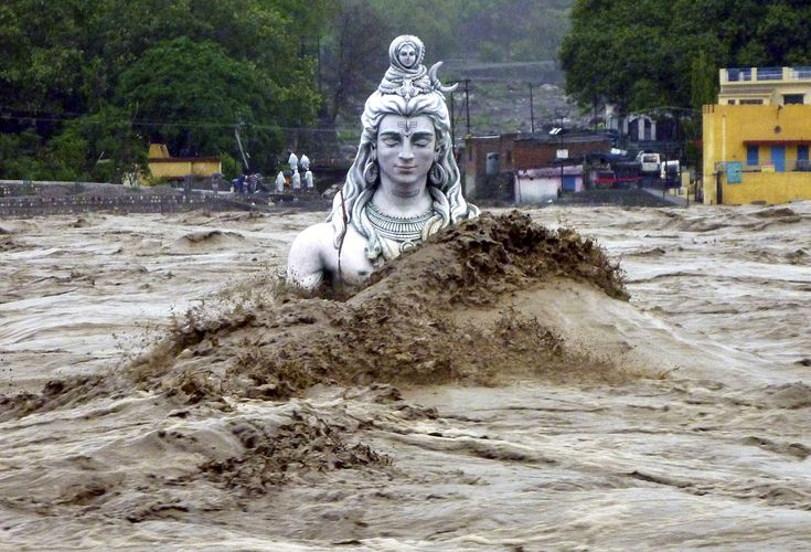 A submerged idol of Hindu Lord Shiva stands in the flooded River Ganges in Rishikesh, in the northern Indian state of Uttarakhand, on June 18, 2013.