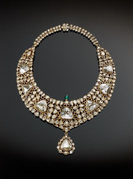 Necklace (kanthi) Object Name: Necklace Date: 1850–75 Geography: South India, Hyderabad Medium: Gold, set with diamonds and emerald; enamel Dimensions: H. 10 1/4 in. (26 cm) W. 7 3/4 in. (19.6 cm) Classification: Jewelry Credit Line: The Al-Thani Collection