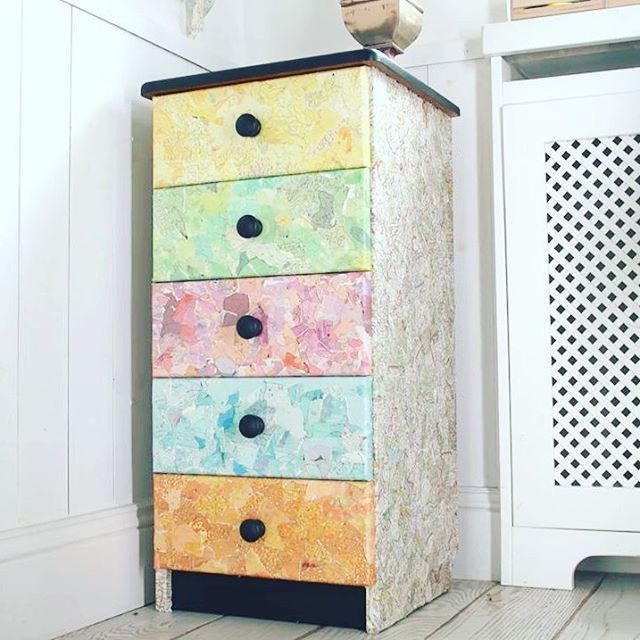 Old chest of drawers upcycled with pices of maps from old atlas