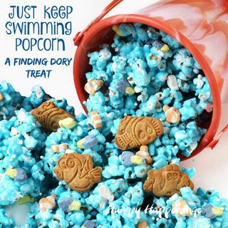Make a splash with your kids by serving them fun Finding Dory Treats. This ocean blue candy coated Just Keep Swimming Popcorn is speckled with Finding Dory marshmallows and cookies and is easy to make