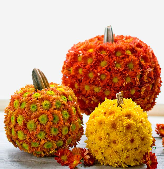 Mum-kin - this involves a real pumpkin with real flowers poked in it.  I wonder if I could use a styrofoam ball with fake flowers and make something that looks like the stem?