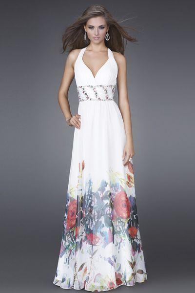 Vestido de fiesta blanco con estampado de flores en la falda.