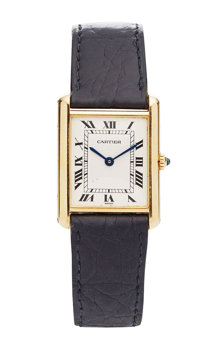 The sexiest watch ever created. Vintage Cartier Tank 18K Yellow Gold Tank Watch On A Black Leather Strap