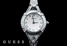 This dainty stainless steel Guess bangle watch with stone detail on the strap is too lovely!
