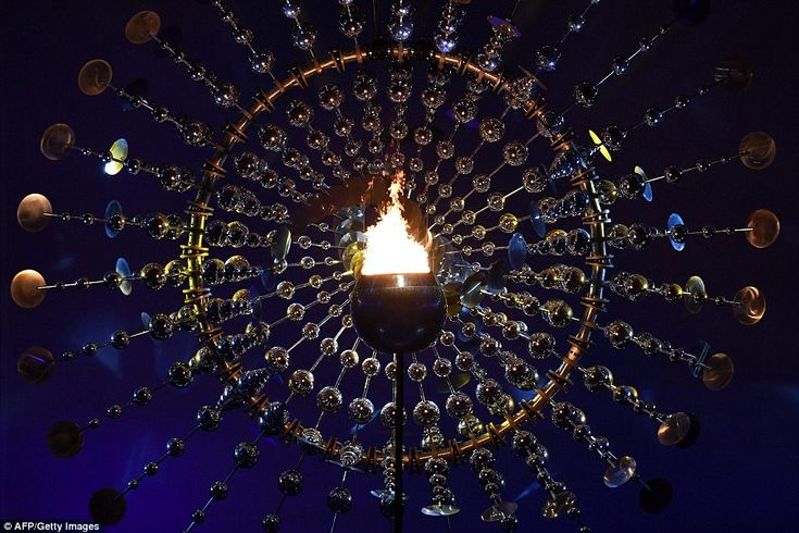 The Olympic flame burning in the Maracana Olympic stadium at the end of the opening ceremony