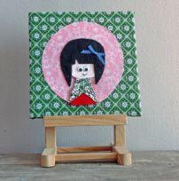 Schilderijtje van stof van een Chinees meisje voor elke babykamer