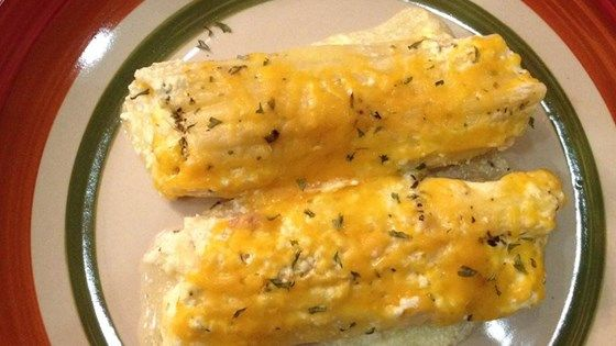 Manicotti stuffed with chicken, spinach and cottage cheese and baked in a sauce made of cream of chicken soup and sour cream flavored with Italian seasoning.