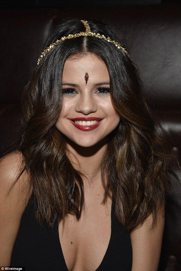 Selena Gomez rocks a sparkly gold headband.
