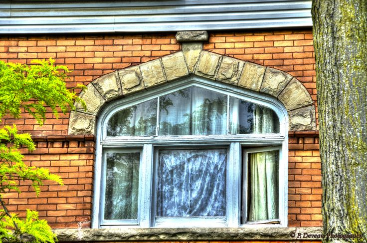 Nice window and stone work on a single family dwelling on Hess St. in Hamilton, Ontario. Built circa 1894.