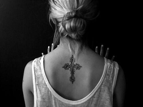 Womens flower & celtic cross tattoo on back