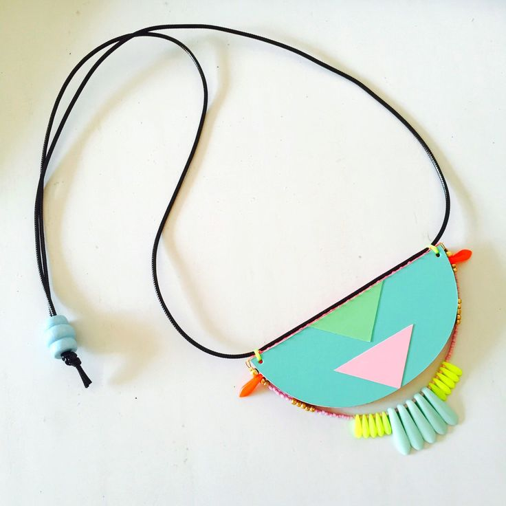 A personal favourite from my Etsy shop https://www.etsy.com/au/listing/270278051/pastels-geometric-tribal-bib-necklace