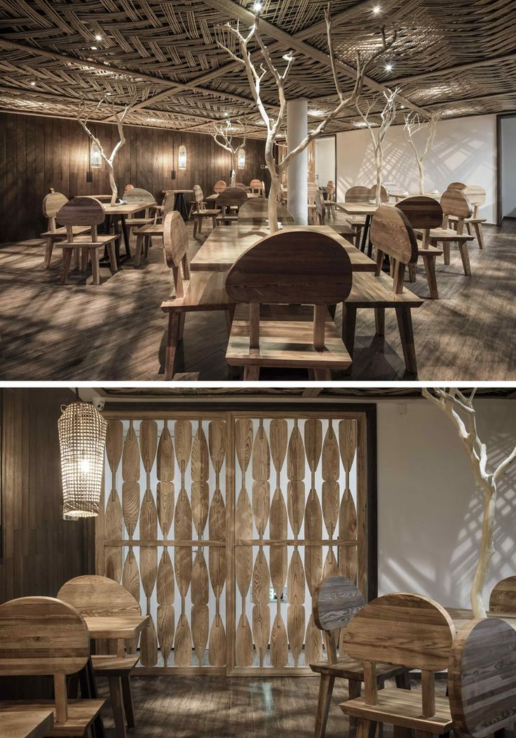 23 Pictures Inside The Ripple Hotel At Qiandao Lake In China // The restaurant features wooden branches on each table, and a patterned wooden screen.