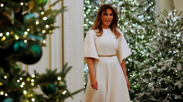 U.S. First Lady Melania Trump greets school children as she tours the holiday decorations with reporters at the White House in Washington, U.S. November 27, 2017. REUTERS/Jonathan Ernst - RC1A66CC6040