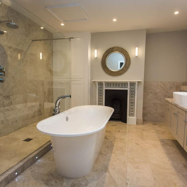 family bathroom design in worcester featuring free standing bath restored fireplace and bespoke handmade cabinets - Bathroom Designs Ireland