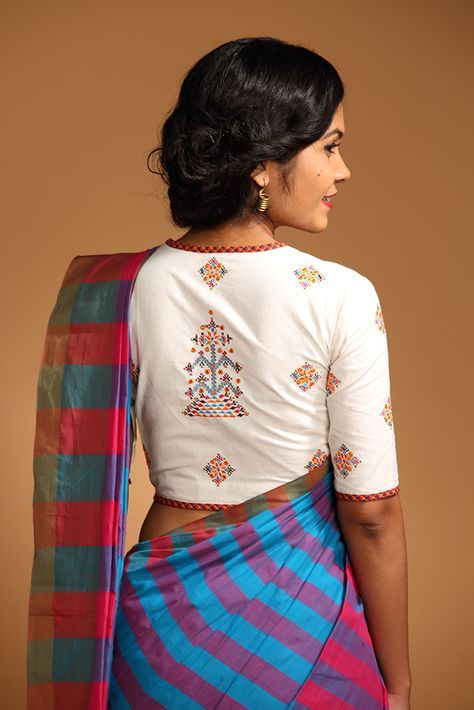 Vellathumbi Blouse – Seamstress Take on the Kerala jacket blouse, the white of this blouse is offset with rich embroidery of many hues. Vellathumbi is malayalam for a white butterfly