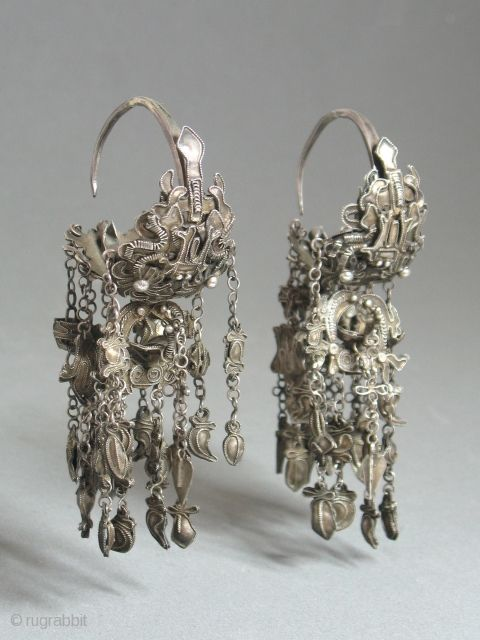 Antique Miao Chinese Silver Earrings |  Each earring comprises three separate parts, each with several charms hanging from chains