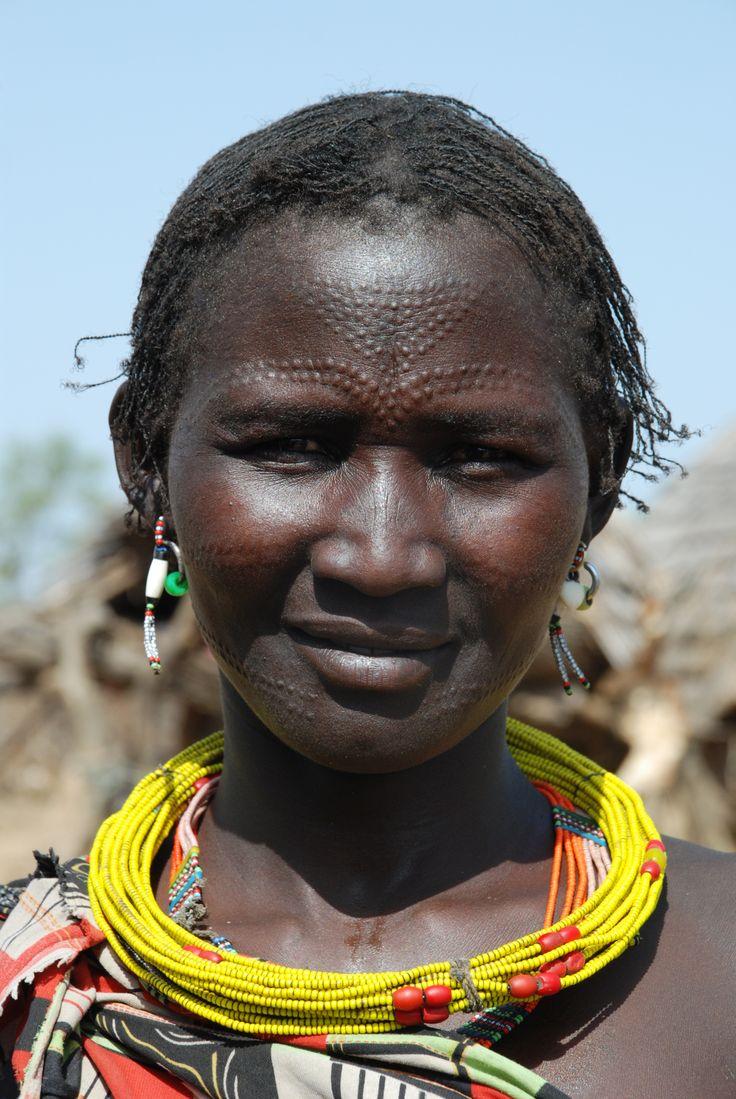 Jie lady | Tribal face, Black african hair, People