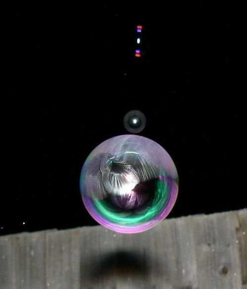 Frozen soap bubbles.  Blow up in air outside.  They freeze coming down.