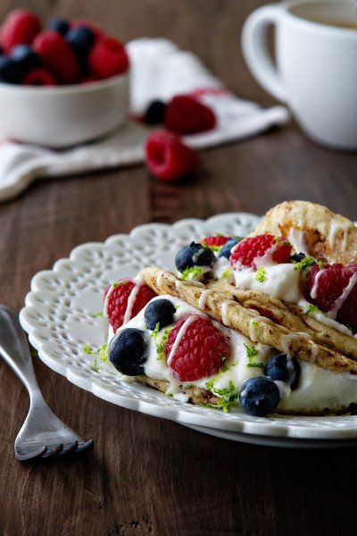 Cinnamon Roll Tacos made with refrigerated cinnamon rolls, fresh whipped cream, and fresh berries.