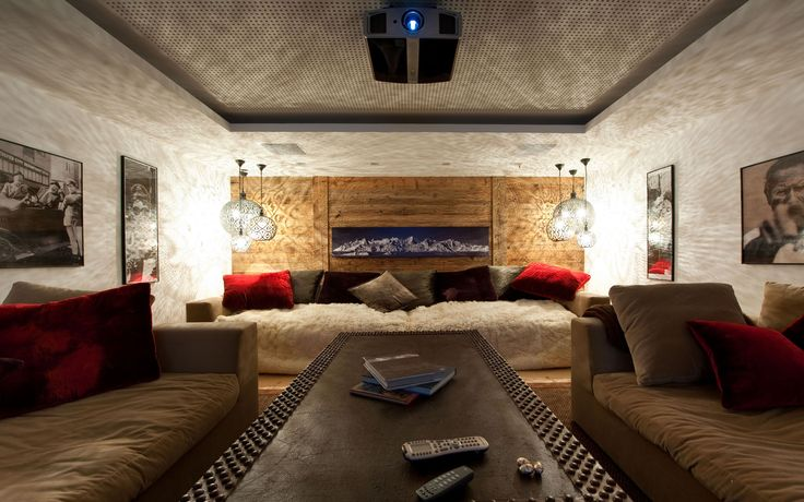 Chalet Dent Blanche - Verbier. Snuggle up in this TV cosy room - the perfect place to relax after a day on the slopes. Available from the Firefly Collection. #luxuryskichalet #verbier #tvroom #cosy  #ski