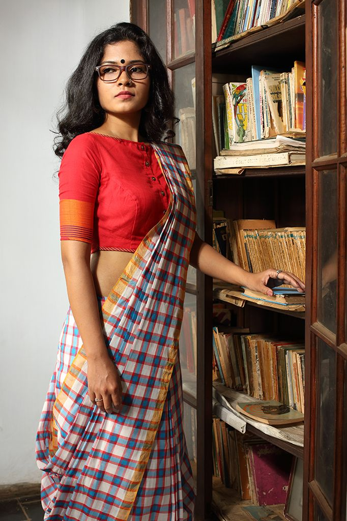 This unique blouse in red with three buttons down the front is quirky. THE KAITHARI PROJECT Hanwoven,designed and tailored in Kerala