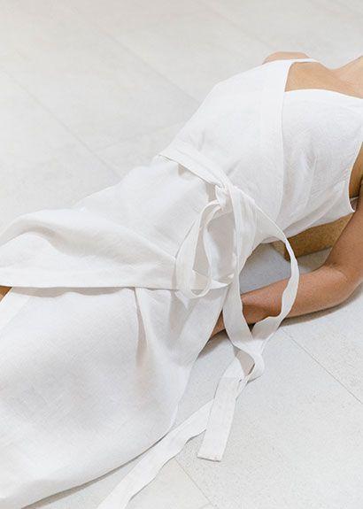 perfect for summer: white linen sleeveless wrap dress
