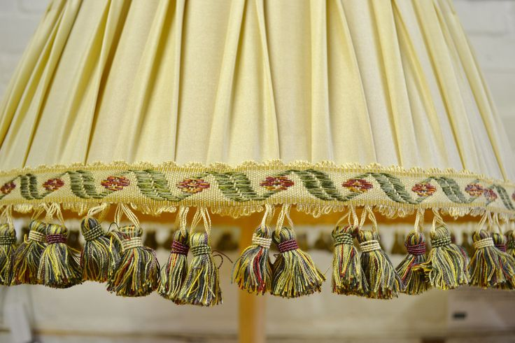 COM lampshade with trim. Very classic and pretty.