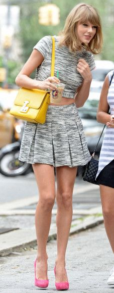 Taylor Swift's grey space dyed crop top and matching skirt with yellow purse