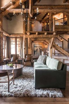 I love the rustic feel of this house! Especially the huge logs bea-u-ti-ful