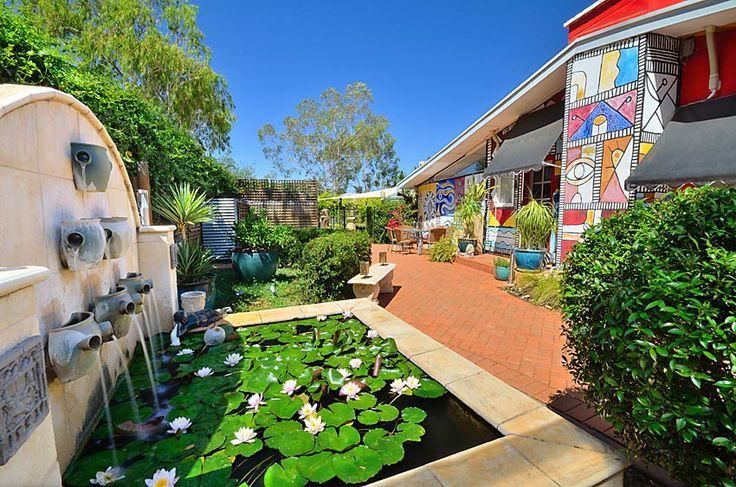 Cascading water into our Lily Pond... www.vatusanctuary.com.au