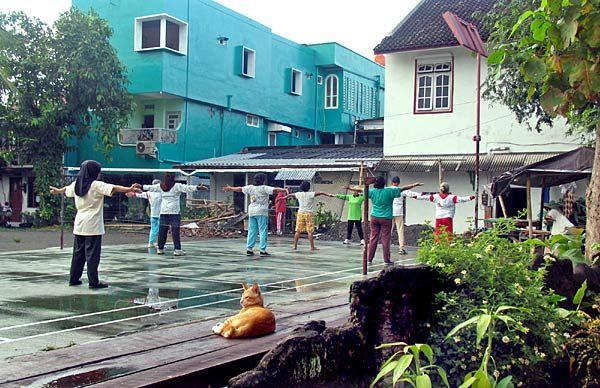 Morning starts with a few calisthenics in an alleyway off Sosrowijayan Street in Yogyakarta, Indonesia