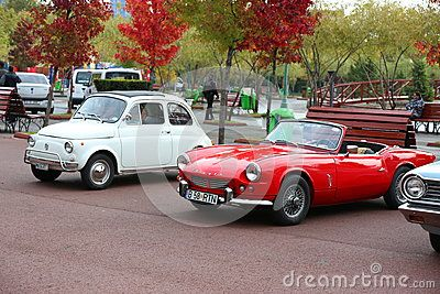 Fiat 500 and Fiat 124 Sport Spider  at vintage cars parade in Bucharest, Romania.