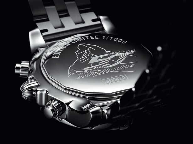"BREITLING Chronomat 44 GMT ""Patrouille Suisse 50th Anniversary"" - The engraved caseback bears the official 50th anniversary logo."