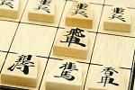 "Pieces of Shogi (Japanese chess) Shogi is a Japanese board game, and is translated as ""Japanese chess"" in English. Tendo city produces more than 90 percent of the pieces of Shogi in Japan. The piece is pentagon-shaped and is made by carving from wood. On both sides of each piece, a name of the role is written with black lacquer or carving."