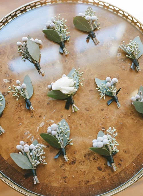 Boutonnieres with a blush tea rose, silver brunia and eucalyptus leaves   @rebeccayale   Brides.com