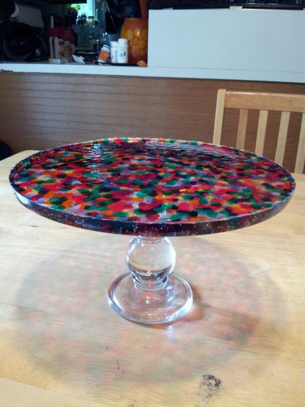 Pony beads melted at 425° for 35 minutes, then attached to a candle stand.  So easy and fun!