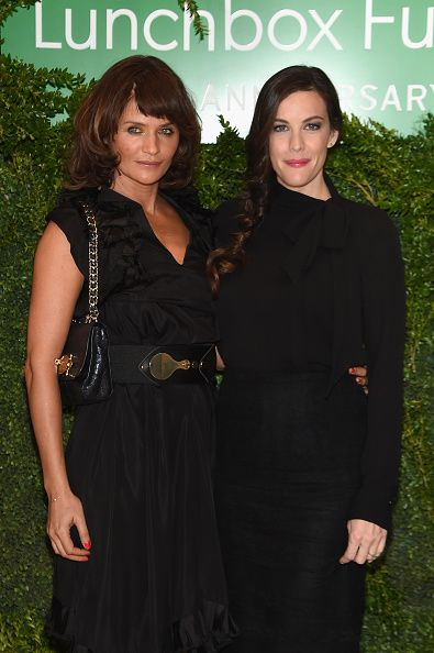 Model Helena Christensen and actress Liv Tyler attend The Lunchbox Fund Tenth Anniversary Benefit Dinner and Auction at Gabriel Kreuther on October...