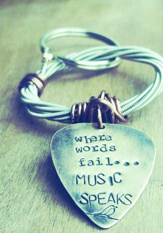 Handstand guitar pick key chain. Wire wrapped coil of guitar strings. When words fail music speaks