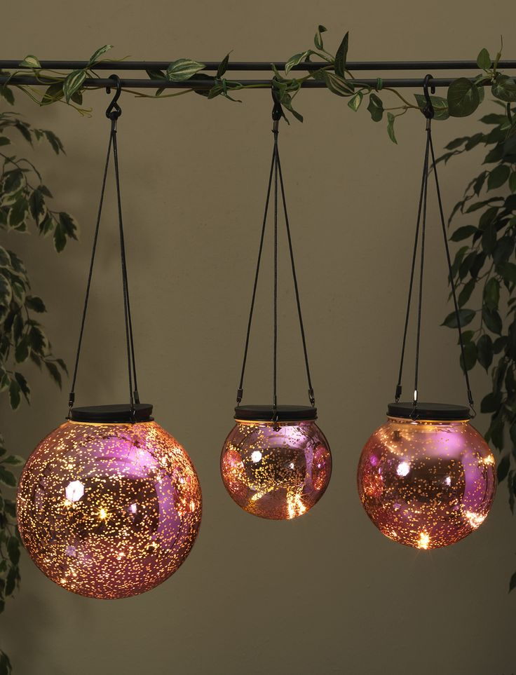 Pink Mercury Glass Orbs That Have A Strand Of Battery