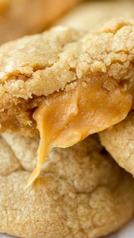 Peanut Butter Caramel Cookies ~ These are the most perfect little peanut butter cookies ever... Soft, chewy, puffy little peanut butter-y bites of heaven. The same recipe you all know and love, with a little gooey caramel surprise inside.