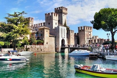 sirmione, lago di garda  No idea what this is, but WOW- that's what I picture when I picture a castle!