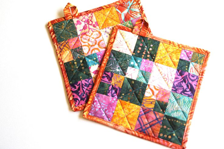 Tropical Quilted Pot Holders Set of Two in Bright and Colorful Batik Fabrics by MyBitOfWonder on Etsy https://www.etsy.com/listing/533592871/tropical-quilted-pot-holders-set-of-two