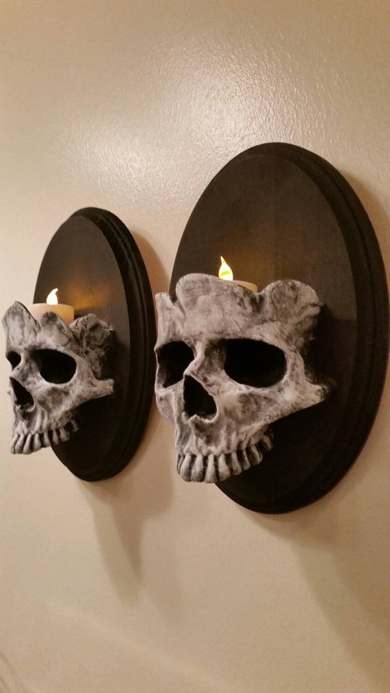 ON SALE! Due to popularity Please allow up to 3 weeks for the pieces to be created and shipped.  This listing is for a set of my skull sconces. I use
