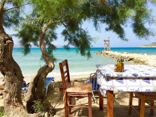 Beach, shade and a tavern means Greek holidays